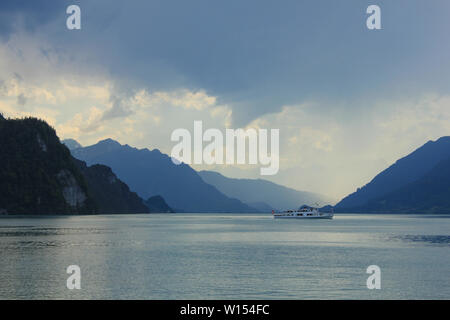 Boat on Lake Brienz and moody sky. - Stock Image