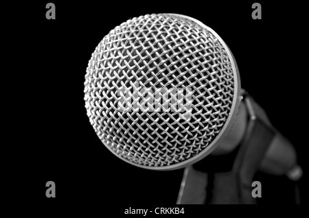 Silver shiny microphone on black - Stock Image