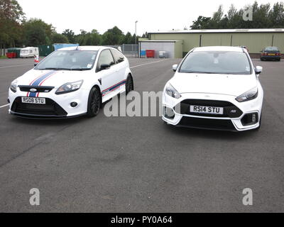 Ford Focus RS mk2 and mk3 shown at donnington park race circuit at the RS owners club national day 2018 both white with personalised registration - Stock Image