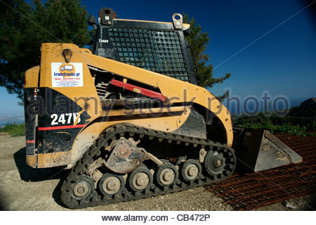 Mini bagger bugger excavation construction digger vehicle site building digging excavator - Stock Image