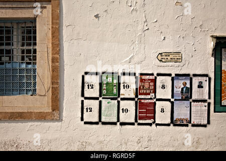 Places fot election posters on the wall in Tunis - Stock Image
