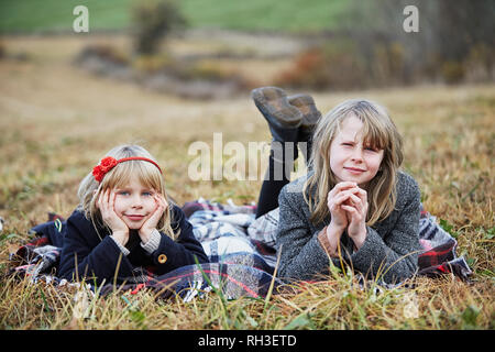 Smiling girls on meadow - Stock Image