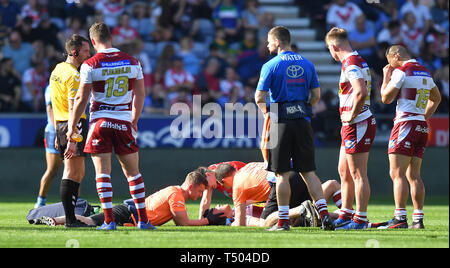 Wigan Warriors' Jake Shorrocks lies injured during the Betfred Super League match at the DW Stadium, Wigan. - Stock Image