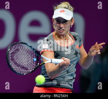 Doha, Qatar. 16th Feb, 2019. Elise Mertens of Belgium hits a return during the single's final match against Simona Halep of Romania at the 2019 WTA Qatar Open in Doha, Qatar, on Feb. 16, 2019. Elise Mertens won 2-1 and claimed the title. Credit: Nikku/Xinhua/Alamy Live News - Stock Image