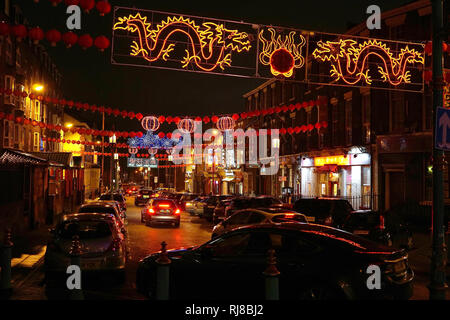 Liverpool, UK. 5th February, 2019. Chinese lanterns and colourful lights light up Nelson Street on Tuesday evening, February 5, in Liverpool's Chinatown for the start of Chinese New Year. Credit: Pak Hung Chan/Alamy Live News - Stock Image