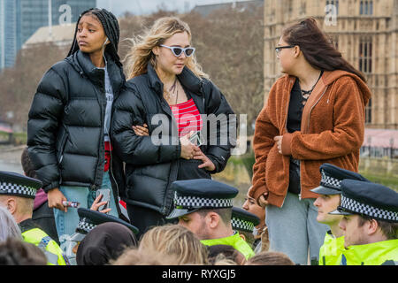 Westminster Bridge, London, UK. 15th Mar 2019. Police move onto the bridge in front of unimpressed students - Extinction Rebellion organise a Youth After Party which blocks Westminster Bridge. The followed and was attended by School students who were striking over the lack of action on climate change. Credit: Guy Bell/Alamy Live News - Stock Image