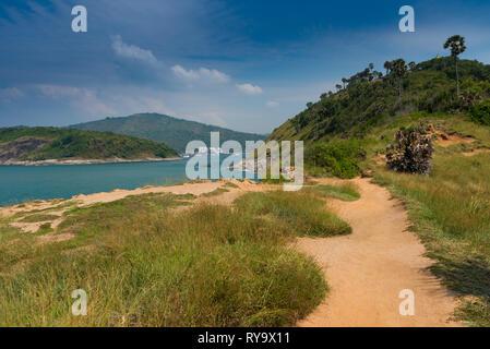 Dirt road trail on Promthep cape, Phuket, Thailand - Stock Image