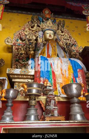Golden Buddha idol in one of the chapels of Ganden Monastery, Lhasa, Tibet, shot in 2007 - Stock Image