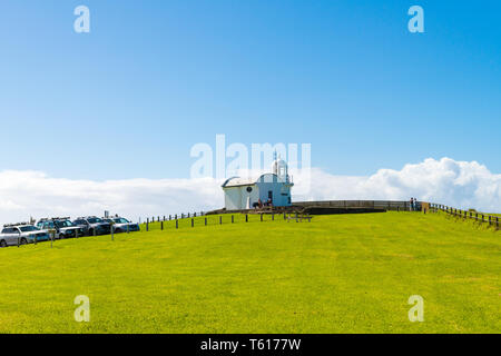 Crowdy Head Lighthouse, NSW, Australia-April 21, 2019: People visiting Crowdy Head Lighthouse, a headland between Forster and Port Macquarie, in New S - Stock Image