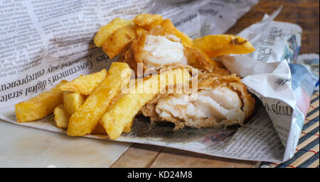 An English fish and chips wrapped in newspaper, the traditional way - Stock Image
