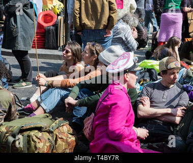 London, UK. 15th Apr, 2019. Climate change protesters In Oxford Circus and Regent street as Environmental protesters paralyse London's roads by creating human barricades at five landmarks. Extinction Rebellion organisers claim 30,000 eco-protesters are expected to block major routes today. They also pulled a boat up Regent Street to highlight the threat of Global Warming, but on a darker side they smashed windows at Shells headquarters. Credit: Keith Larby/Alamy Live News - Stock Image