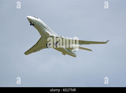 Falcon 7X from Air Alsie Fleet departing from Inverness Dalcross Airport in the Scottish Highlands UK. - Stock Image