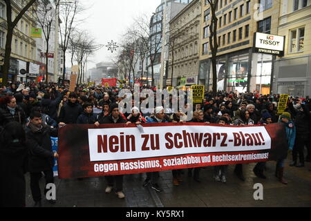 Vienna, Austria. 13th Jan, 2018. anti-government protesters carry a banner through Vienna's main shopping street. - Stock Image