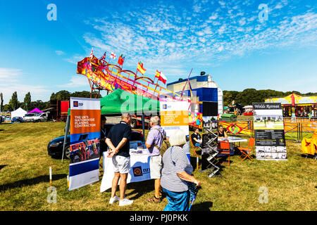 Crowds enjoying the hot summers day at the Revesby Show, Lincolnshire 05/08/18. Stalls and old farm equipment to view during another hot day, NRP - Stock Image