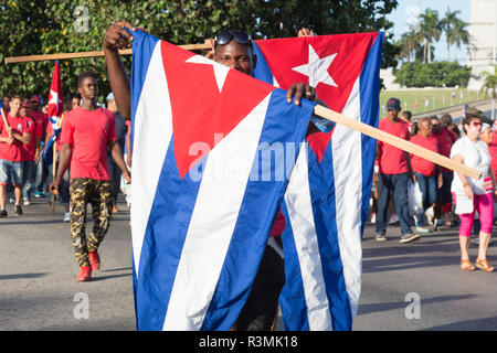 Cuba, Havana, Revolution Square. Marchers holding Cuban flags. Credit as: Wendy Kaveney / Jaynes Gallery / DanitaDelimont.com - Stock Image