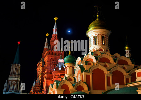 Moscow, Russia; Kazan Cathedral and towers from the History Museum in Red Square at night - Stock Image