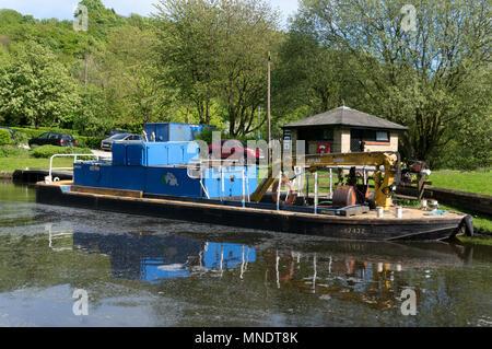 Canal maintenance barge at Salterhebble on the Calder & Hebble Navigation, Halifax, West Yorkshire - Stock Image