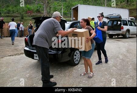 FEMA volunteers deliver emergency supplies to Puerto Rican residents during relief efforts in the aftermath of Hurricane - Stock Image