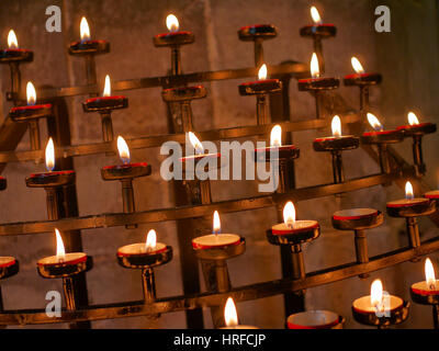 Prayer candles in St. Davids Cathedral, Wales UK. - Stock Image