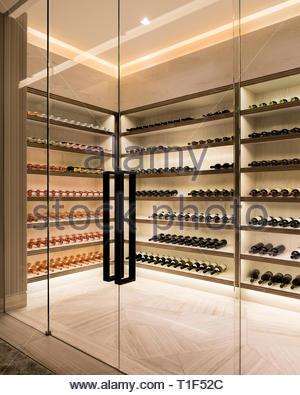 Glass doors to modern cellar - Stock Image