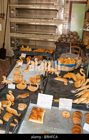 Bakers with animal shaped offerings Rethymno Crete Greece - Stock Image