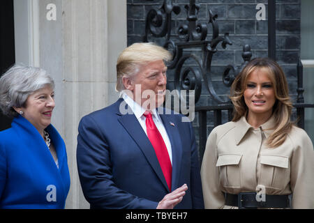 London, UK. 4th June, 2019. Theresa May, President Trump and Melania Trump pose for photographers outside 10 Downing Street during his Three day State visit to the UK. Credit: Keith Larby/Alamy Live News - Stock Image