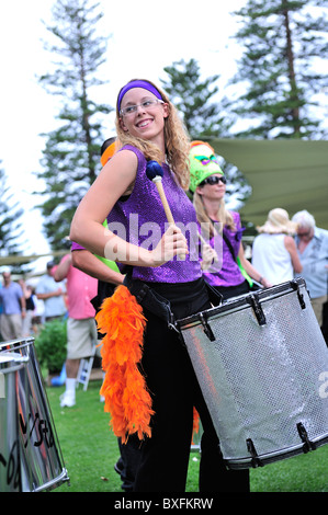 Young woman playing drums in marching band. Fremantle, Western Australia - Stock Image