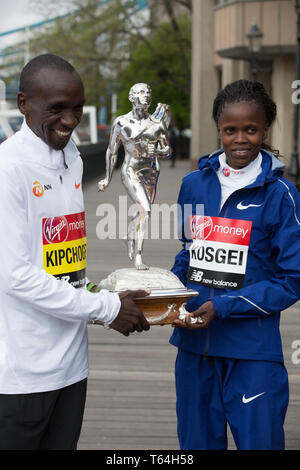 London,UK,29th April 2019,The London Marathon Winners photocall took place outside the Tower Hotel. Kenyans Eliud Kipchoge and Brigid Kosgei both made history as Eliud was the first Elite Man ever to win on four occasions and Brigid was the youngest ever women's winner at 25 years old.Credit: Keith Larby/Alamy Live News - Stock Image