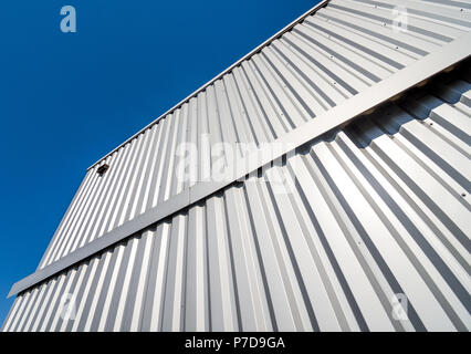Aluminium cladding on building wall - France. - Stock Image
