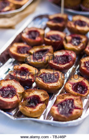 Fresh baked half apples with sweet marmalade - Stock Image