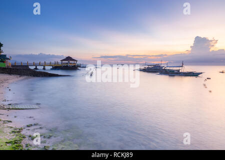 Sunset view of the Moalboal beach famous diving and snorkeling spot in Cebu, Philippines - Stock Image