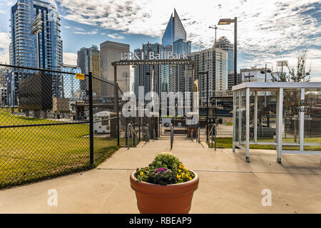 CHARLOTTE, NC, USA-1/8/19: The BB&T Ballpark in uptown Charlotte, with skyscrapers in background. - Stock Image