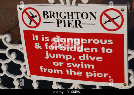 Danger sign at Brighton Pier, England - Stock Image