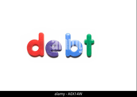 alphabet  magnets spelling debt words - Stock Image