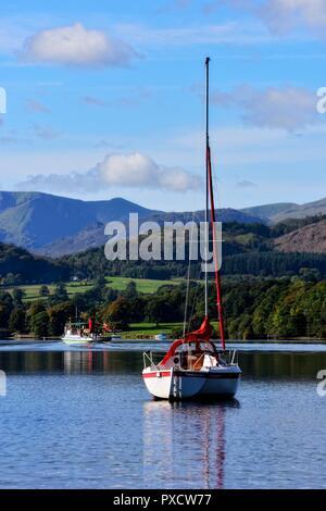 A yacht on Ullswater Lake,Lake District National Park,Cumbria,England,UK - Stock Image