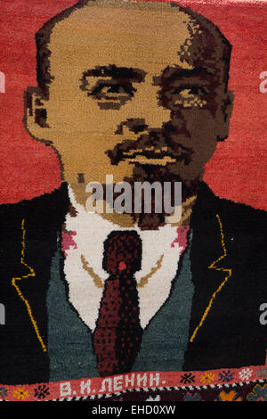 Woven carpet commemorating Lenin for sale at a stall in Bukhara, Uzbekistan - Stock Image