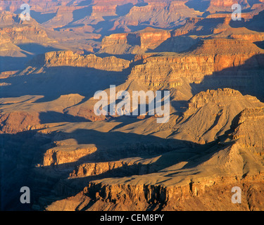 Walls of sedimentary rocks of Grand Canyon at sunrise, view from Lipan Point on South Rim of Grand Canyon National - Stock Image