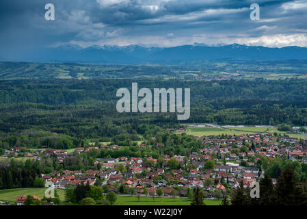 Hohenpeißenberg, Germany- May 19, 2019. Aerial view of the town of Peissenberg with the Alps in the background in the spring during the day , from Hoh - Stock Image