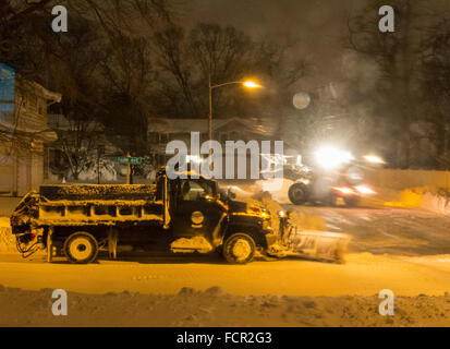 Merrick, New York, USA. 24rd January 2016. Two Town of Hempstead snowplows, a small one plowing out a cul de sac, - Stock Image