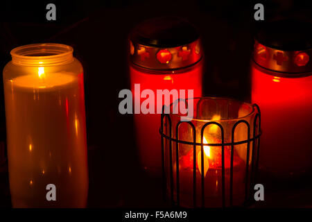 Candles burning in the night - Stock Image