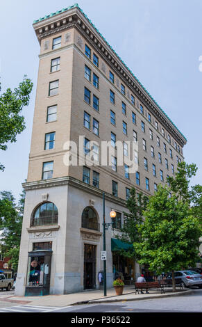 ASHEVILLE, NC, USA-10 JUNE 18:  The 1926 flatiron building, a retail and office building at Battery Park and Wall Streets. - Stock Image