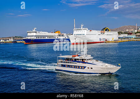 Broufas Vessels passenger ferry Georgios Mproufas II with Blue Star 1 &  Elyros port of Piraeus Athens Greece Europe - Stock Image