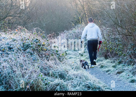 Aberystwyth Wales UK, 04/01/2019  UK Weather: A man walks his dog on a  cold and frosty morning in Aberystwyth , west Wales after a night of clear skies as a static high pressure system dominates the weather over the countryPhoto credit Keith Morris / Alamy Live News - Stock Image