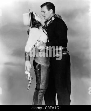 Ella Raines and John Wayne / Tall in the Saddle /  1944 directed by Edwin L. Marin [R.K.O. Radio] - Stock Image