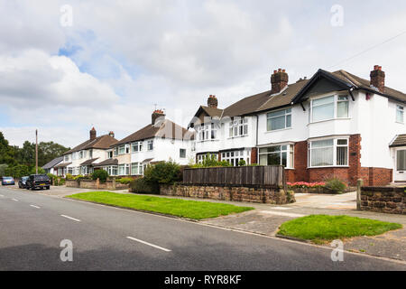 Semi-detached houses on Quarry Street, Woolton, Liverpool. Suburban houses dating from the mid twentieth century. - Stock Image