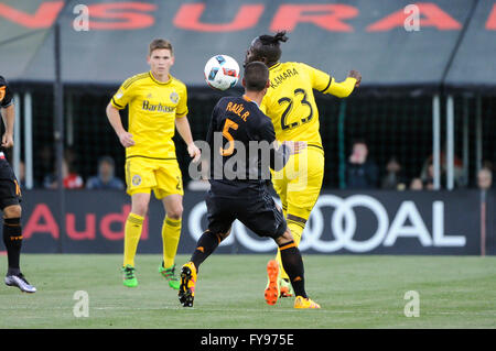 Mapfre stadium, USA. 23rd April, 2016. .Columbus Crew SC forward Kei Kamara (23) heads the ball past Houston Dynamo - Stock Image