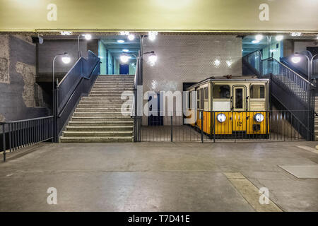 Klosterstraße U-Bahn underground railway station serves the U 2 line in Mitte, Berlin. Interior with tiled walls & pictures of historic buses & trains - Stock Image