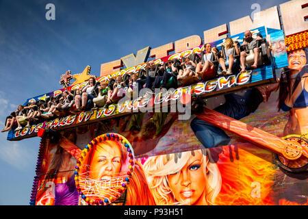 UK, England, Lancashire, Blackpool, South Pier, visitors on Extreme funfair ride - Stock Image