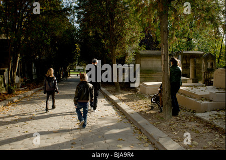 Paris, France - Young Family Walking in Urban Park, Pere Lachaise Cemetery, Monument - Stock Image