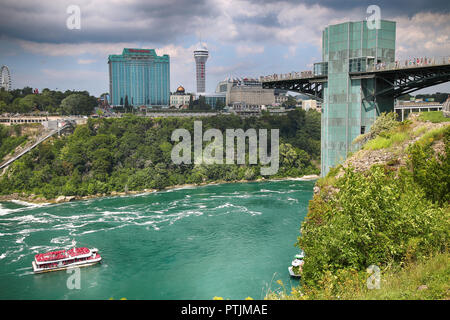 Niagara Falls, USA – August 29, 2018: Beautiful view of Rainbow Bridge from American side and the Canadian side with famous hotels across, New York St - Stock Image